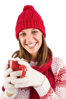 Young woman enjoying her hot coffee in the winter