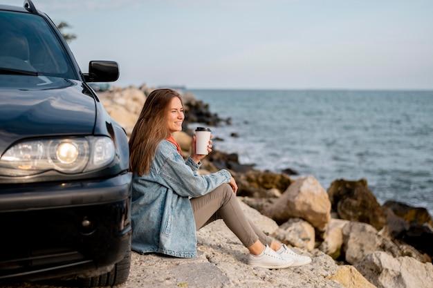 Young woman enjoying road trip