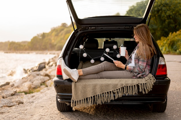 Young woman enjoying road trip