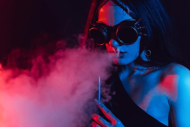 Young woman enjoys smoking a hookah