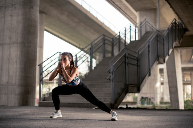 Young woman exercise in urban environment