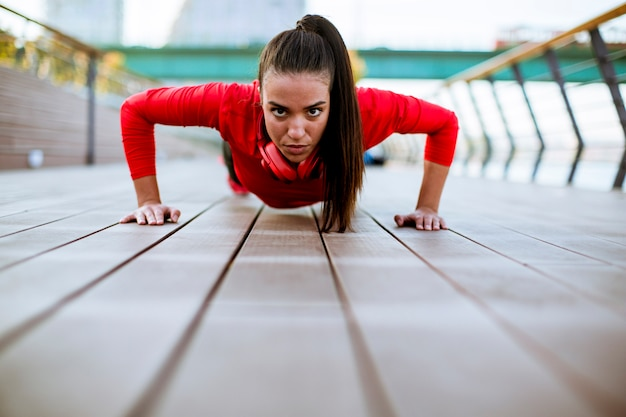 Young woman exercises on the promenade after running