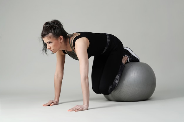 Young woman exercising, fitness