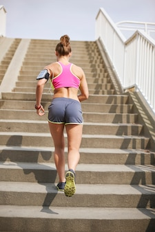 Young woman exercising outdoor. good weather to start jogging