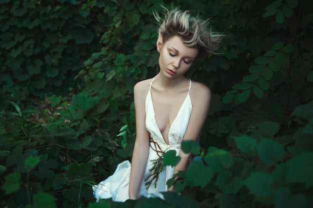 Young woman in a fairy dress in nature