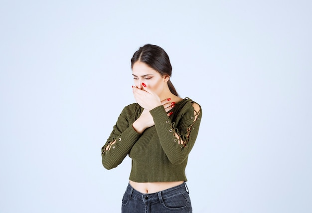 Young woman feeling sick on white background. Free Photo