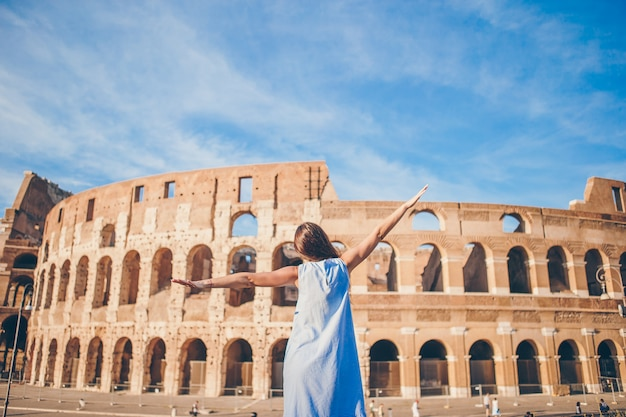 Young woman in front of colosseum in rome, italy, girl in europe vacation