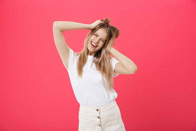 Young woman getting angry ,crazy and shouting isolated on a pink background.