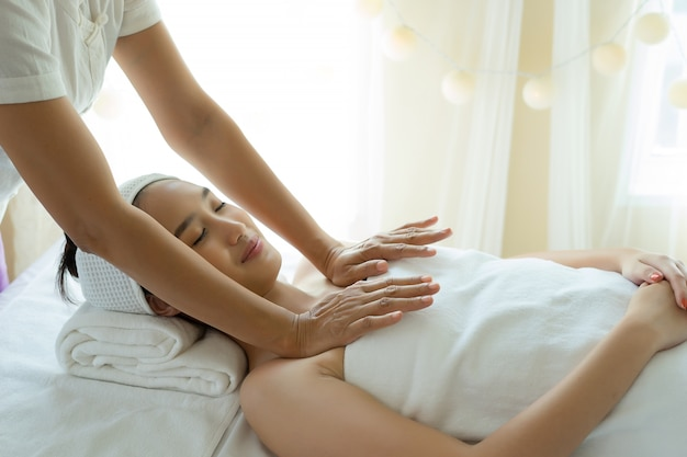 Young woman getting body massage at spa.