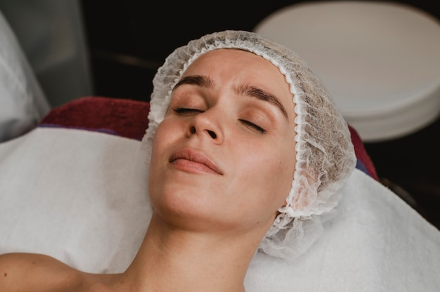 Young woman getting a cosmetic treatment at the spa
