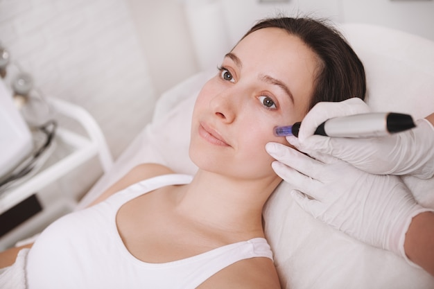 Young woman getting facial skincare treatment