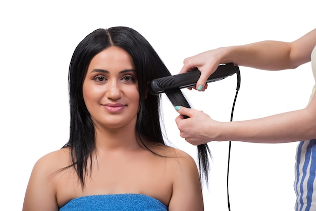 Young woman getting hair straightner isolated