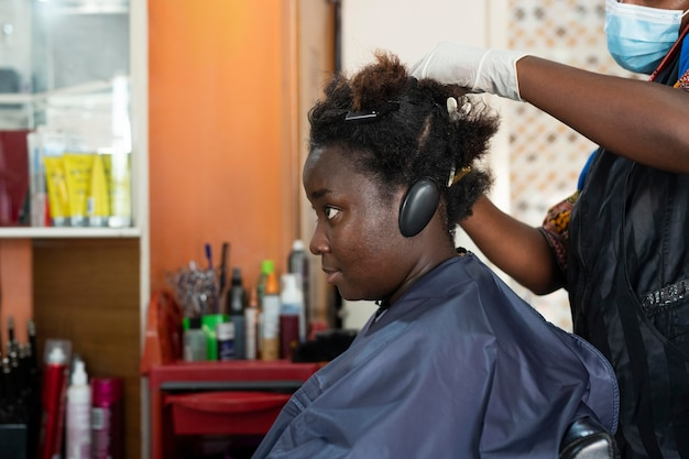 Young woman getting her hair done at the salon