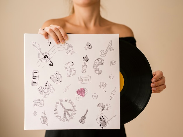 Young woman getting out vinyl record
