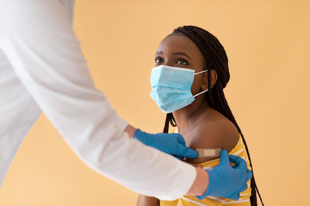 Young woman getting vaccinated close up
