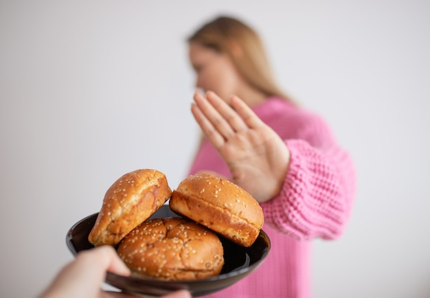 Young woman on gluten free diet is saying no thanks to bread