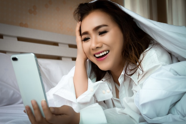 Young woman happiness with smartphone
