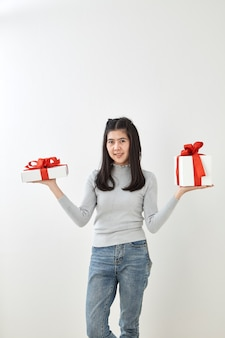 Young woman happy hold gift box in hands
