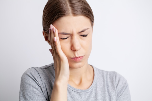 A young woman has a severe headache
