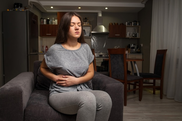 Young woman has a stomachache, gallbladder disease