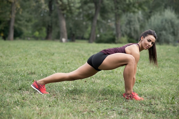 Young woman have workout in the park