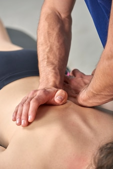 Young woman having chiropractic back adjustment