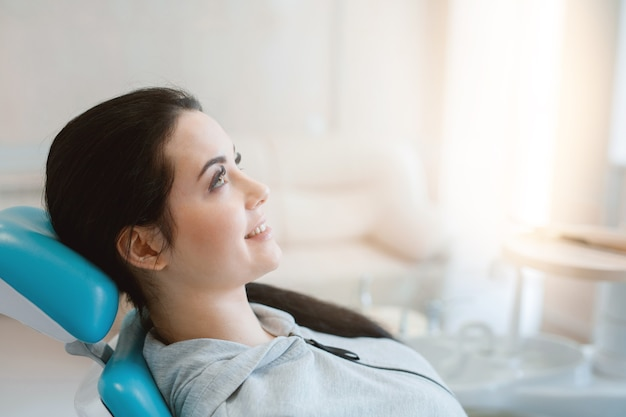 Young woman having dental treatment at dentists office Premium Photo
