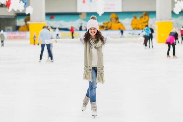 Young woman having fun on skating rink