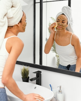 Young woman having a homemade mask on her face
