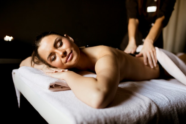Young woman having a hot stone massage