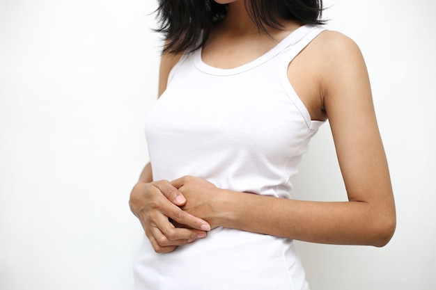 Young woman having painful stomachache. abdomen bloating