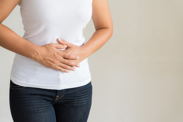 Young woman having painful stomachache. chronic gastritis