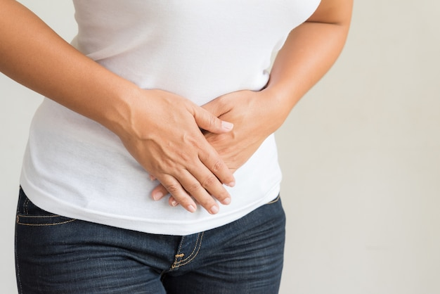 Young woman having painful stomachache. chronic gastritis.