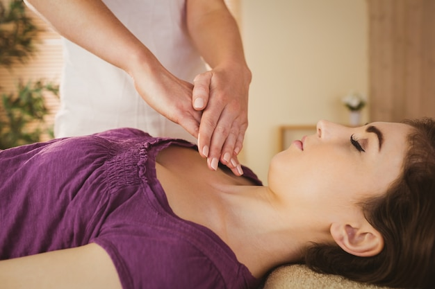 Young woman having a reiki treatment