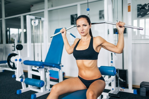 Young woman having strength workout.