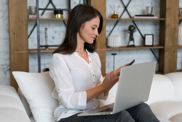 Young woman having a videocall on her device