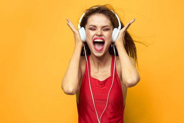 Young woman in headphones having fun and laughing