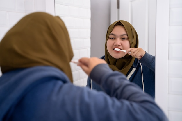 Young woman hijab doing routine activities