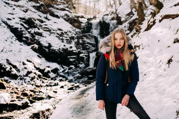 Young woman on a hike in a winter forest