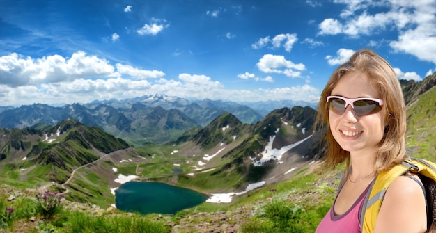 Young woman hiker and lake oncet in the french mountains pyrenees