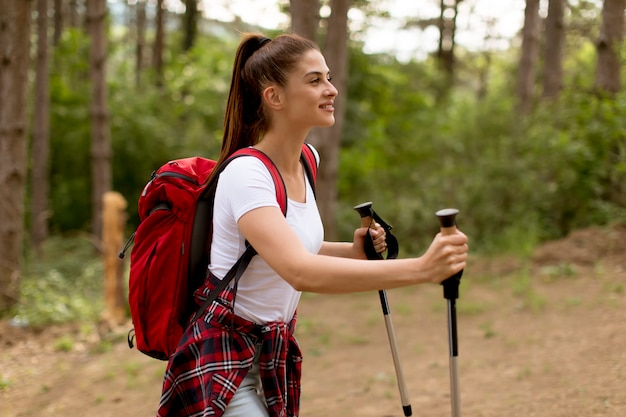 Young woman hiking on forest track