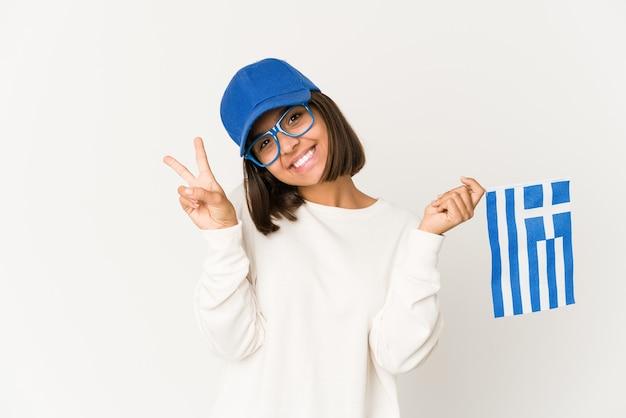 ギリシャの旗を保持している若い女性