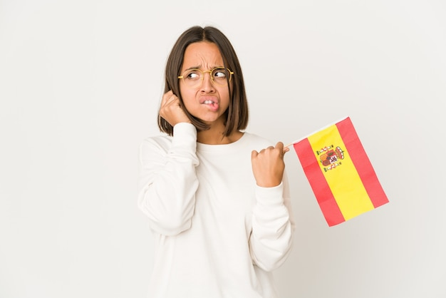 スペイン国旗を保持している若い女性