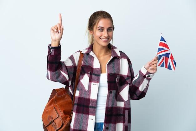 素晴らしいアイデアを指している白の英国旗を保持している若い女性