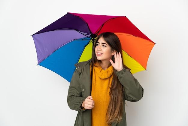 傘を持っている若い女性 Premium写真