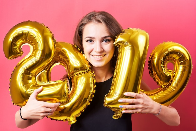 Young woman holding   balloons in hands
