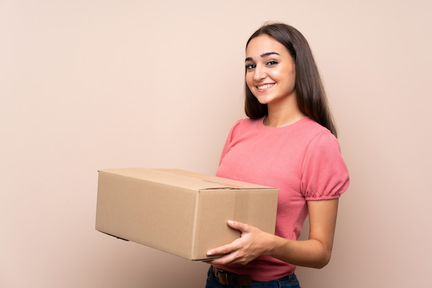 Young woman holding a box to move it to another site