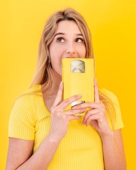 Young woman holding cassette