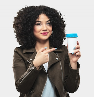 Young woman holding a coffee