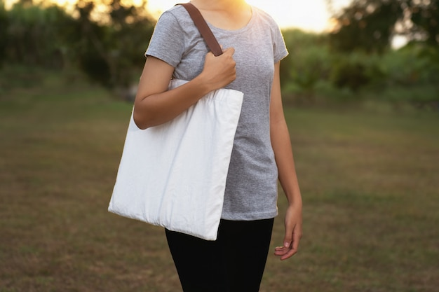 Young woman holding cotton. eco concept